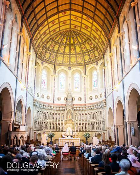 Inside of St Aloysius church Oxford during wedding ceremony