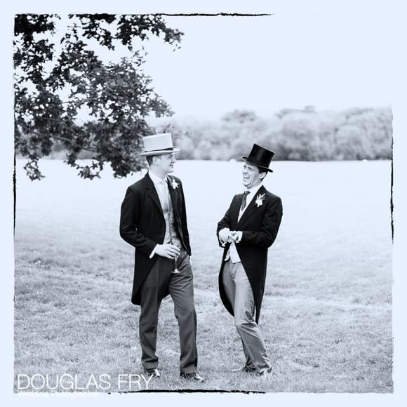 Guests wearing top hats at wedding reception near Abingdon - black and white photograph