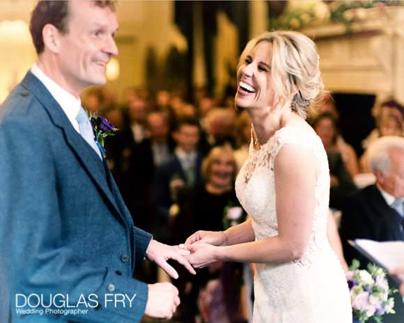 Bride and groom laughing during the marriage ceremony