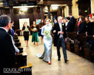 Bride and father of the bride walking down aisle at St Lawrence Jewry in London