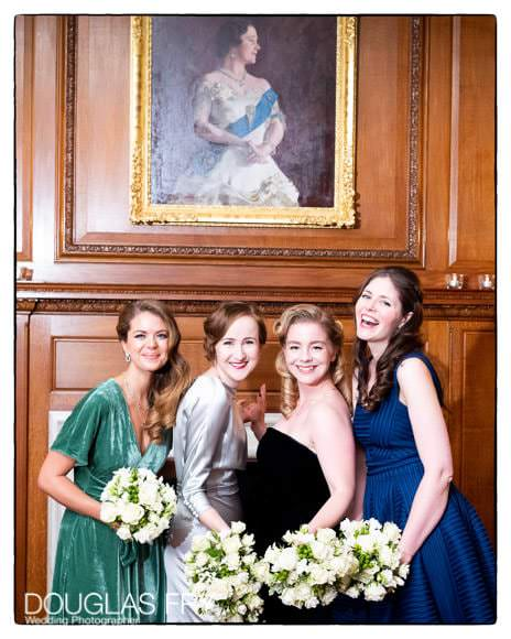 Bride with girl frends photographed at London Wedding