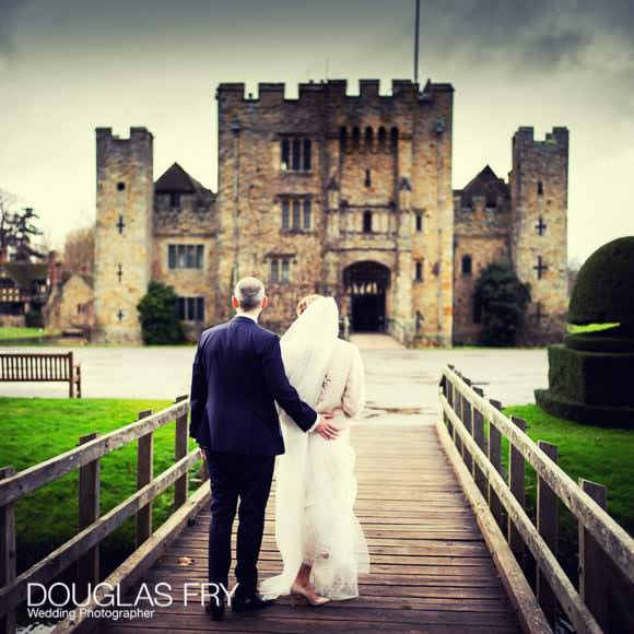 couple photographed with Hever Castle behind