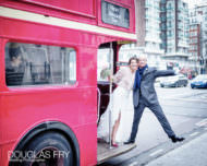 Photograph of bride and groom on London routemaster bus