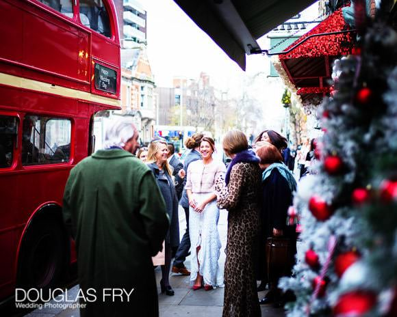 Bride with Christmas trees and bus in front of the Ivy Chelsea