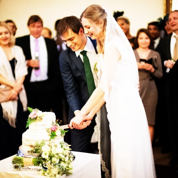 Cutting of the cake at London wedding