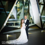 Couple standing outside Searcy's the Gherkin - photographed by Douglas Fry Wedding Photographer