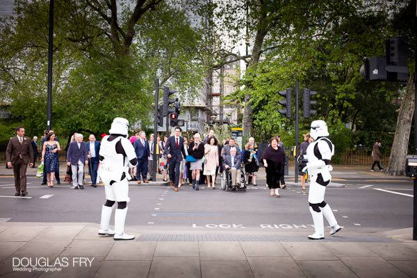 Guests crossing London road with Stormtroopers - Star Wars theme.