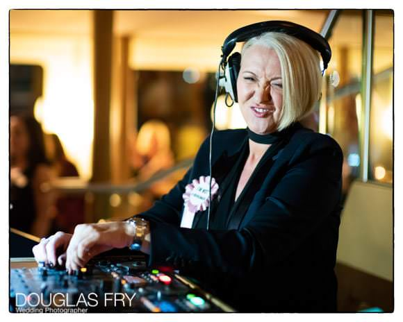 Friend at wedding as DJ