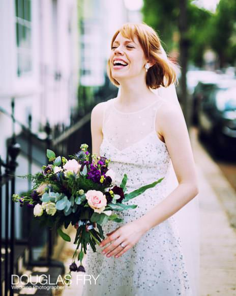 Natural photograph of bride with bouquet in Chelsea street after wedding