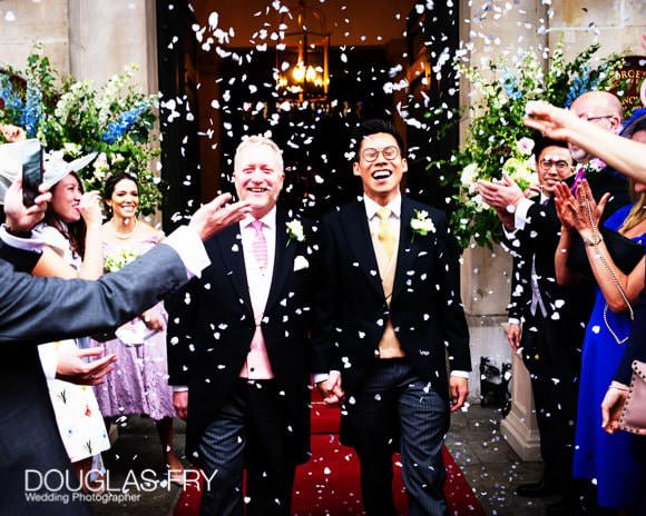 Couple with confetti in front of St George's Hanover Square in London