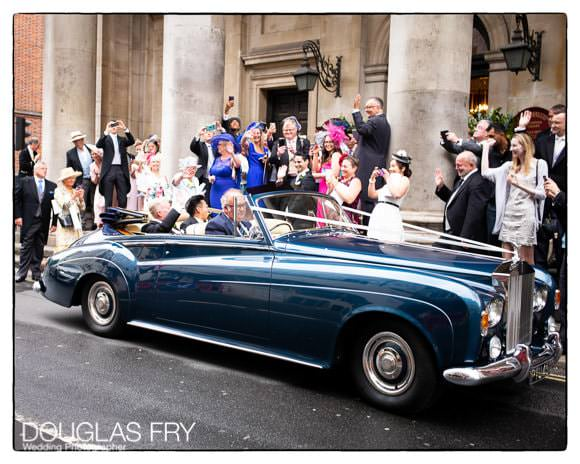 Wedding party with car in front of London church - wedding photograph