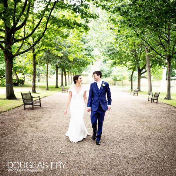bride and groom walking outside at Gray's Inn photographed by Douglas Fry