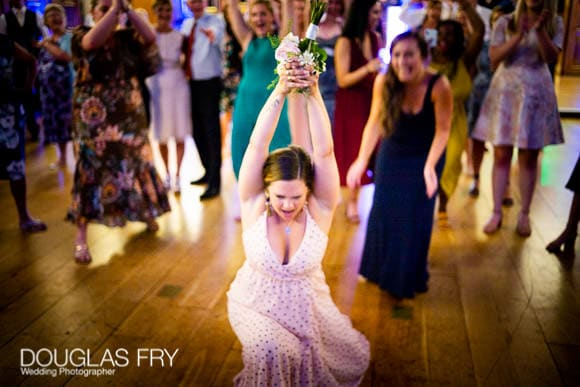 Photography of Bride Throwing Her Wedding Bouquet at Gray's Inn in London! 2