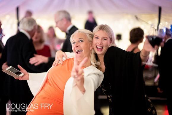 Guests dancing on dance floor at party