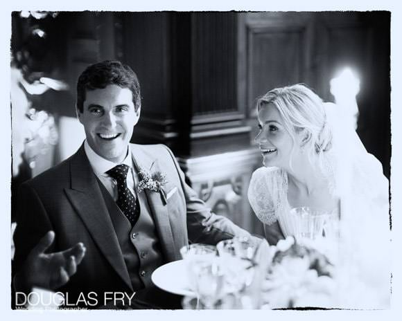 Black and white photograph of couple at dinner