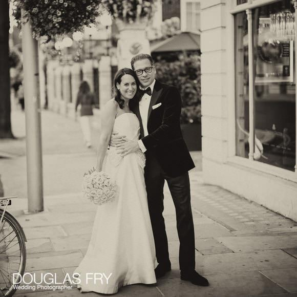 Chelsea street with Bride and groom pictured in black and white