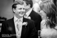 Bride and groom pictured in black and white