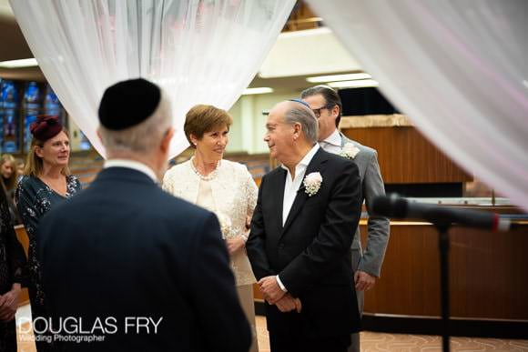 Bride and groom photographed under the chuppah