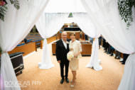 Bride and groom under Chuppah during jewish wedding ceremony in London