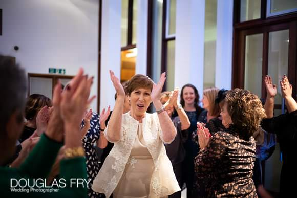 Wedding St John's Wood Synagogue - bride enjoying the day