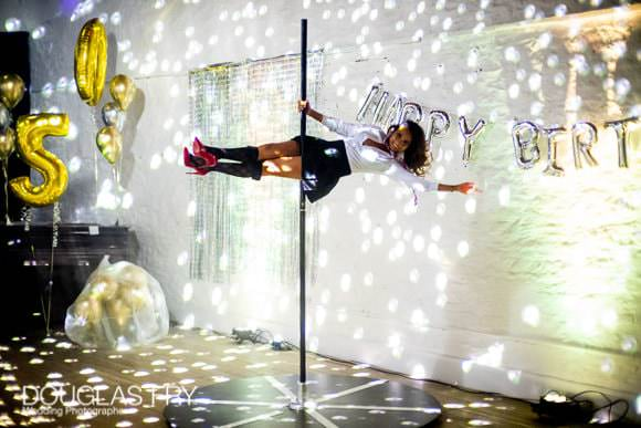 Photograph of pole dancing at party