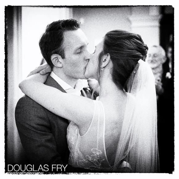 Bride and groom kisssing at end of wedding ceremony