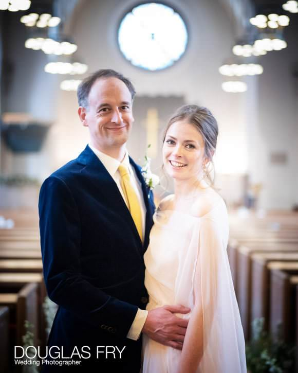 The wedding couple pose for some portraits in the foyer of the church