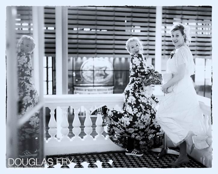 Two guests posing for a fun photograph on the balcony