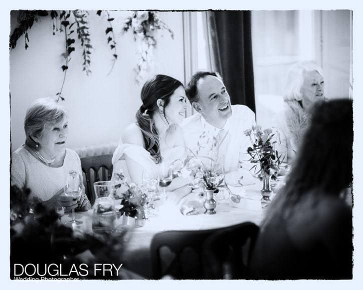 The wedding couple enjoying the speeches