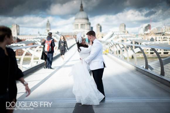 Portraits of the wedding couple posing on the Millennium Bridge