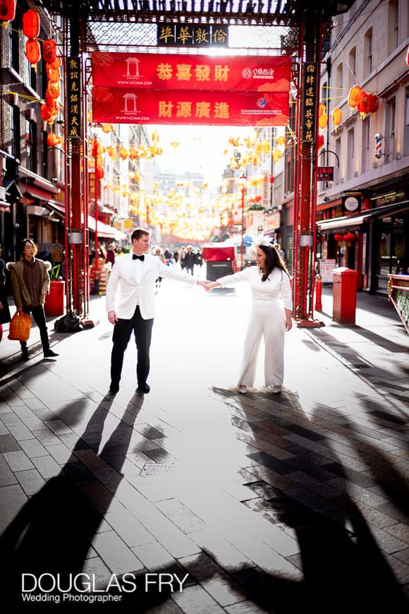 Sunny backlit wedding portraits of the wedding couple taken in Chinatown in London