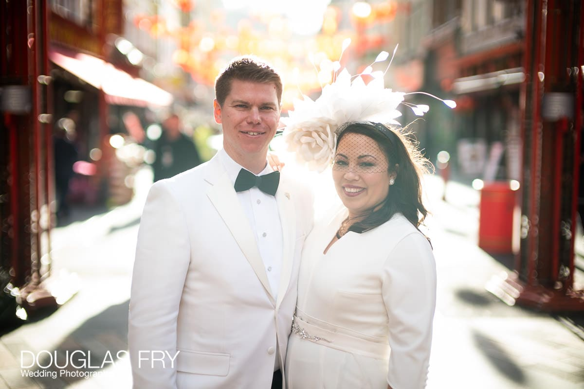 Portrait of wedding couple in Chinatown - London