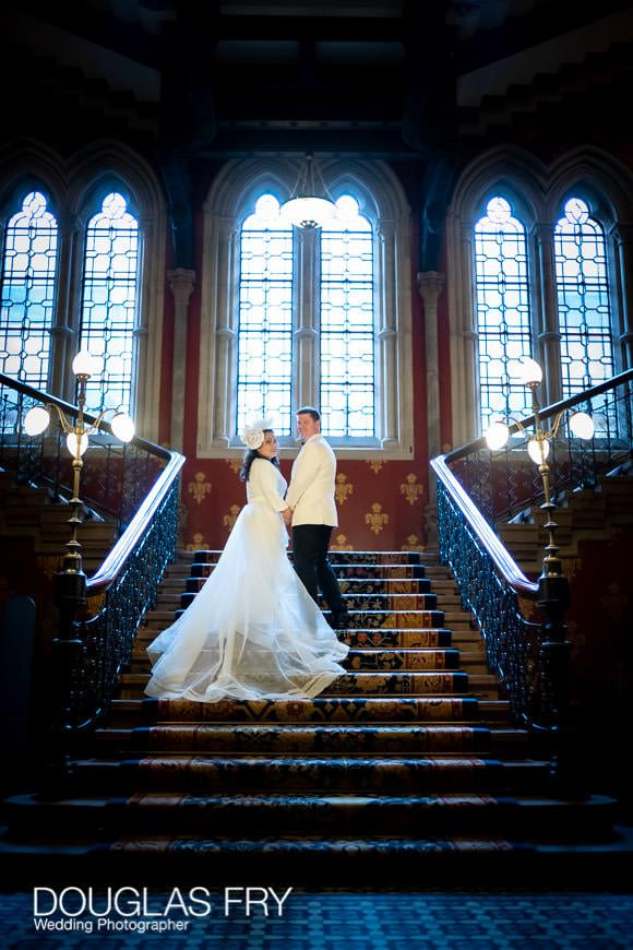wedding couple posing on the stairs of The Landmark hotel in London