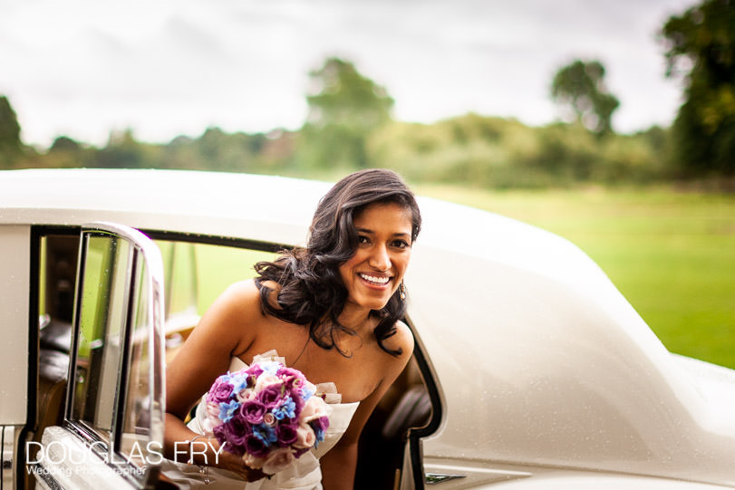 Bride arriving at syon park in rolls royce