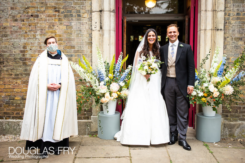 couple in front of London church with facemask