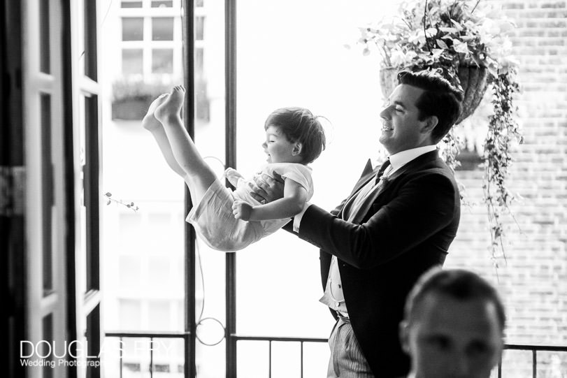 child at reception of wedding in London