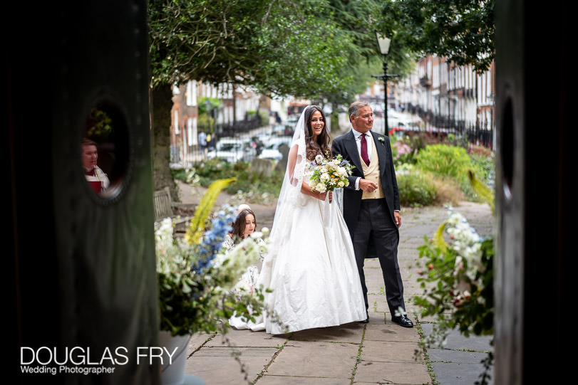 Bride arriving at church with father in london