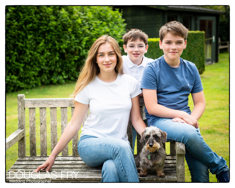 Teenage children and dog photographed at home in Wiltshire