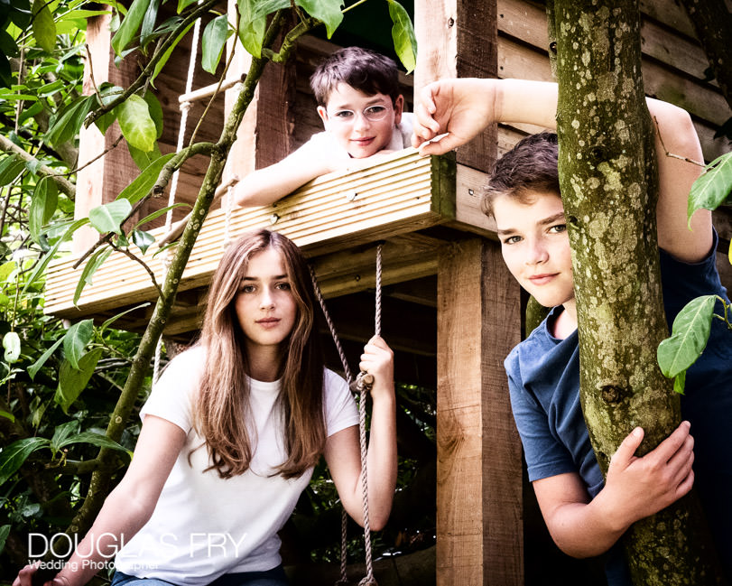 Teenage children and dog photographed at home in Wiltshire with Treehouse