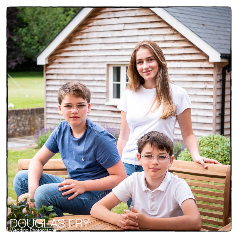 Teenage children and dog photographed at home in Wiltshire in the garden