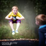 Berkshire family photography - children playing on trampoline at home