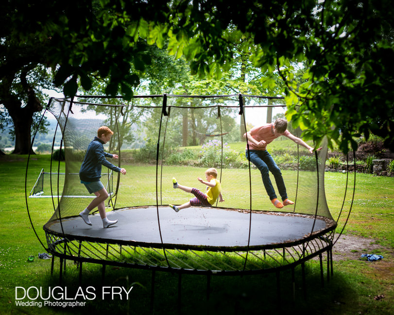 Family photography of children on trampoline at home in Berkshire