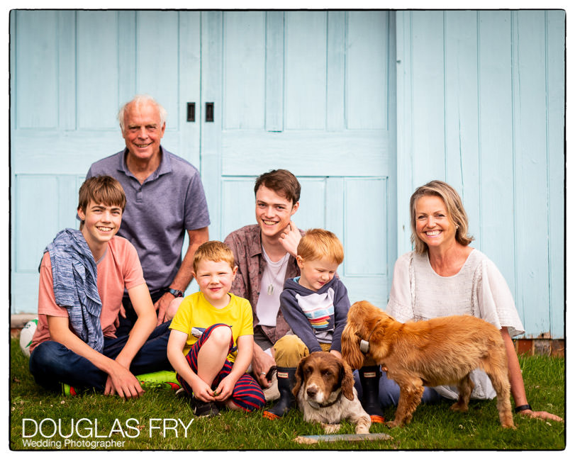 Group photograph of family together at home in Berkshire
