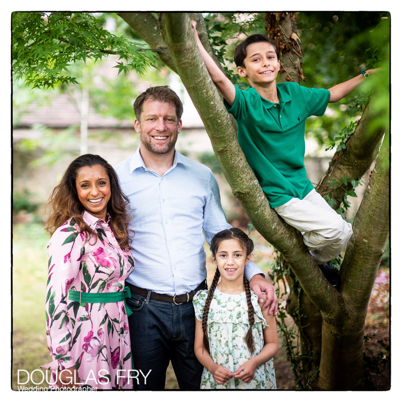 Family photographed together in garden near Oxford