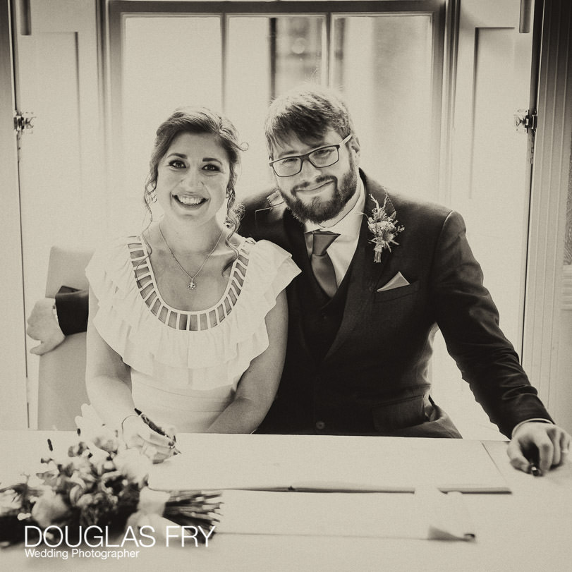 Socially Distanced Wedding Photography signing register in London