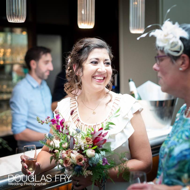 Bride enjoying wedding reception at Socially Distanced Wedding in London