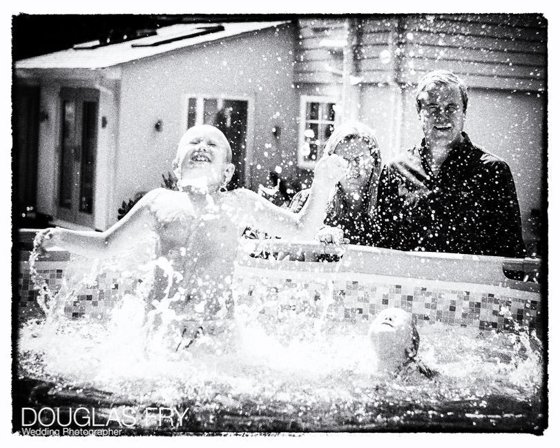 Children playing in swimming pool during photo shoot