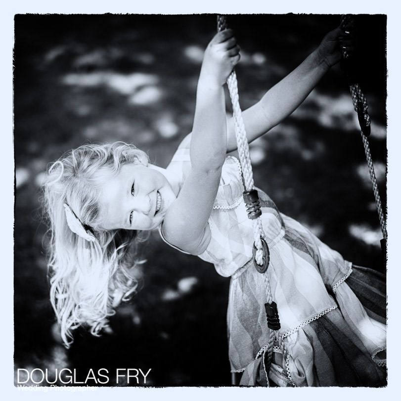 Girl photographed on garden swing