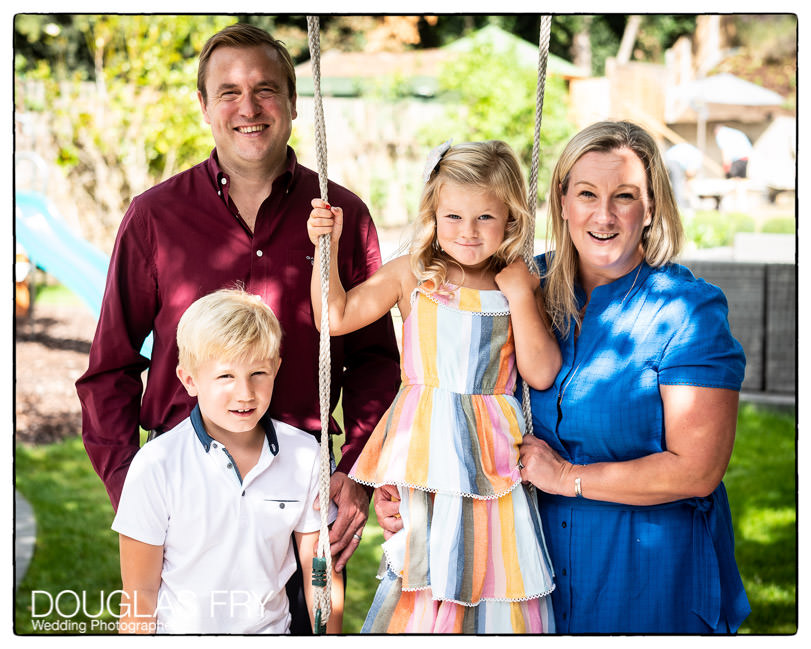 FAmily photographed together in garden
