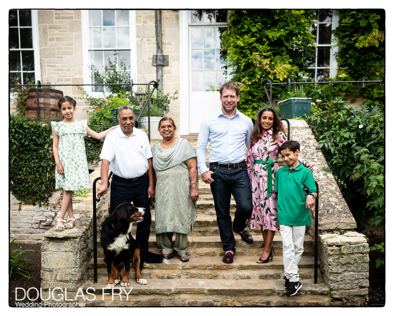 The whole family photographed together in front of the house